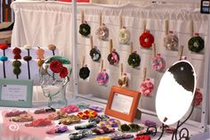 Craft Booth Display - notice the mirror so people can model the hair accessories and hats!