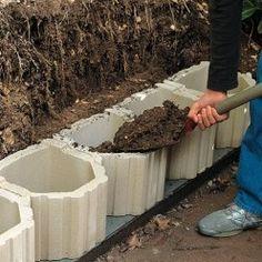 Mur de soutènement : solution de nivelage de terrain - Подпорная стена - remplissage des blocs pour un mur de soutènement -