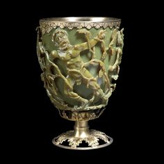 The Lycurgus Cup at the British Museum - this 4th century piece is possibly the oldest existing example of Dichroic glass work. The opaque green cup turns to a glowing translucent red when light is shone through it. The glass contains tiny amounts of colloidal gold and silver, which give it these unusual optical properties.
