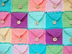 Crocheted Advent Calendar - free pattern by Michelle Villa / MooeyAndFriends. Made as 25 individual pockets stitched together.