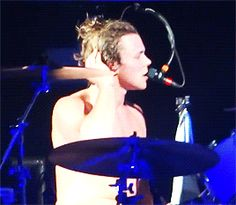 Ashton drumming shirtless, I'm an Ashton girl so this is the most perfect thing on this planet. <3