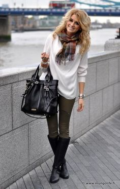 Olive pants, white sweater, black boots. Love her hair too deff going for that look