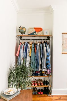 The clothing rack is DIY in lieu of a closet.