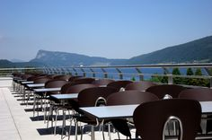The factory of Jaeger-LeCoultre watches by Lac de Joux in Switzerland with STUA Globus chairs for outdoor. Swiss qualtity chairs. (by Etat de Siege)