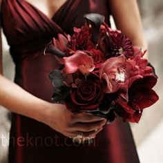 Red Bridesmaid Bouquets  Mary's bridesmaids carried all-red bouquets of spray roses, orchids, amaryllis, and calla lilies.