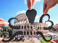 Paperboyo Rich McCor paper cut-outs around travel art landmarks
