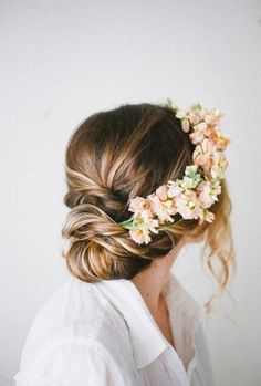 Add fresh flowers for a boho-chic 'do! #bridalbeauty #wedding #hairstyles