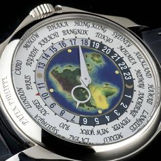⌚World Time Wonder⌚  #PatekPhilippe #WorldTime ref #5131G-010 in 18k white gold. Featuring a silver dial with an enamel centre depicting the world map.  Patek Philippe have now stopped production of this model in white gold.