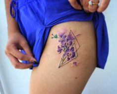 Watercolor orchids on thigh by Bryan Gutierrez