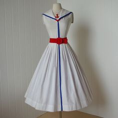 - 1940's - early 1950's jerry gilden spectator cotton pin-up dress    -quintessential sailorette design    -Jerry Gilden was a maker of moderately-priced women's ready-to-wear in the 1940s into the 1960s. He started his manufacturing business in 1945 and ten years later was one of the top five producers of women's dresses in the United States.  classic silhouette with a fitted bodice and a full and swingy skirt    -kerchief snaps into place under collar    -side metal zipper    -belt NOT inc...