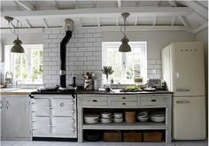 So many lovely ideas - white/off-white, tile splashback just for the cooker, pendant lights, removing drawers from a chest (though I see the top ones are sagging as the support's been removed....), distressed paint mixed with pristine and dark work surface/light surface mix. Nice