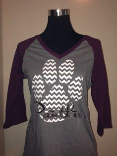 Chevron Panthers Raglan Tee sold by Martin Nest Designs. Shop more products from Martin Nest Designs on Storenvy, the home of independent small businesses all over the world.