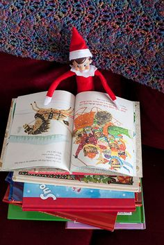 Elf reading christmas story books
