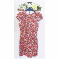 Beautiful NWT Zara floral mini dress! Bright floral patterned dress in a very flattering material. Never worn with tags. Zara Dresses Mini