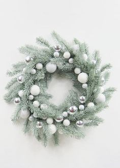glittered pine wreath with silver and white balls