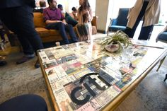 Sir Lucian Grainge's Artist Showcase: A range of old-school concert stubs—from a time when people saved them as souvenirs, before digital ticketing was the norm—arranged under a glass tabletop created eye-catching, on-theme decor.