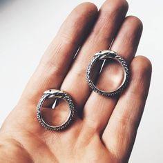 Two sterling silver ouroboros rings - sizes US 4 on the left and ~US 7 on the right. By The Gilded Fish