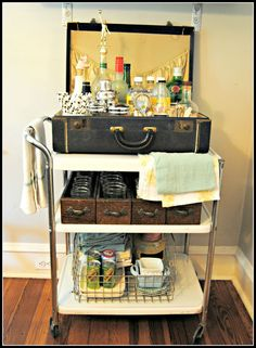 with Flea Market Finds Wire baskets are great to gather all your entertaining supplies. Easy to find and add another layer to your bar set up The vintage suitcase add charm and texture. Find a cart with wheels, or simply… Flea Market Booth, Flea Market Style, Flea Market Finds, Flea Market Displays, Flea Markets, Brimfield Flea Market, Diy Interior, Interior Design, Repurposed Furniture