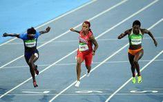 Tori Bowie of the United States, Michelle-Lee Ahye of Trinidad and Tobago and Murielle Ahoure of the Ivory Coast compete in the Women's 100m Semi final on Day 8 of the Rio 2016 Olympic Games at the Olympic Stadium on August 13, 2016 in Rio de Janeiro, Brazil.