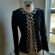 TAHARI. ....GORGEOUS SILVER/BLACK...BLAZER. ...EXCELLENT CONDITION  ...LIKE NEW ...NO FLAWS ...GORGEOUS  ...A MUST HAVE ...true to it's Size and color... ...tag size 4...also fits size 6... ...2 pic up close ...blazer style ...design on front ...beautiful detail ...down front open ...MTRL...SHELL. ..100%polyester  ...Lining. ...100%polyester  ...Dry clean only.. ...better in person Tahari Jackets & Coats Blazers