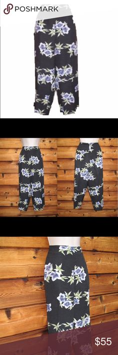 """Like  New Tommy Bahama Silk Floral Cropped Pants Tommy Bahama Silk Shantung Crop Length Hawaiian Print Pants, Size 10, Black  *Like-new.  Details: Tommy Bahama Color: Black with Blue-Violet floral pattern Size: 10 Back zip closure No pockets Unlined 100% Silk shantung Dry clean only  Measurements: Waist: 32"""" Hips: 42"""" Inseam: 22"""" Front Rise: 11.5"""" Tommy Bahama Pants Ankle & Cropped"""