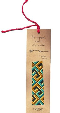 """Kitenge Fair Trade African Proverb Orphan's Tears Bookmark  Kenya - Use this bookmark to mark your place in your favorite book or give as a gift to your teacher. Bookmark made of recycled paper and up-cycled kitenge fabric swatches. Fabric colors and patterns vary. African proverb reads: """"An orphan's tears run inside"""" A fair trade product from Kenya. This bookmark was made by men of different ethnic groups who are working together to build strong homes, families, and communities. Your…"""