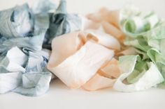 A DIY technique that produces an effect similar to marbling is dip dyeing. Thin fabrics like muslin will absorb the color and pattern really well. Use ripped cloth as ribbons to wrap around menus or bridesmaid bouquets.