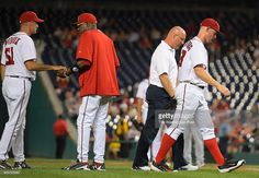 Washington pitching coach Mike Maddux (51), left, hands manager Dusty Baker (12), center left, a trainer Paul Lessard walks starting pitcher Stephen Strasburg (37), right, off the field after getting injured on the top of the 3rd inning with one out as the game ball as as the Washington Nationals play the Atlanta Braves at Nationals Park in Washington DC, September 7, 2016.