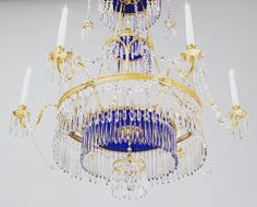 Photo #55 of #707070. A continental chandelier which is really, really pretty and we like it a lot. Some people think chandeliers such as these with their colbat blue glass are Russian, but this one has a German makers stamp on it.