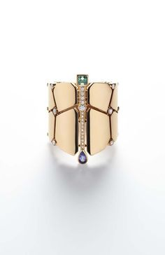 Hermès Niloticus rose gold cuff featuring a series of coloured stones including a pear-shaped iolite and a baguette-shaped beryl as well as brilliant-cut diamonds