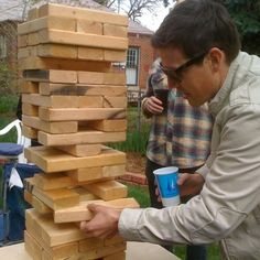 "DIY outdoor version of Jenga get out some and cut them into approx 10 ½ "" long pieces. Once you have 54 pieces, sand them up a little, stack 'em, and challenge everyone to a match! Our favorite bar has one of these on the patio -- giant jenga!"