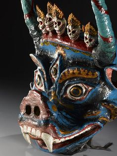 Tibetan dragon mask  This fearsome Tibetan dragon mask would be worn by a participant in a traditional Devil Dance.  This object featured in the  exhibition 'Treasured: Wonderful Things, Amazing Stories' at the National Museum of Scotland, Edinburgh.
