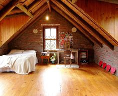 adore this A-frame attic bedroom / office space / exposed brick / wood