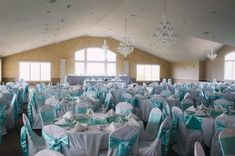 Tiffany Blue themed wedding at Metamora Fields, Metamora, IL.  Tiffany blue satin sashes on white chair covers.  Glamorous, elegant, and romantic wedding decoration perfect for spring for summer wedding reception.