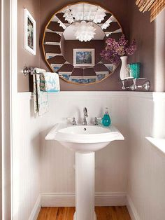 Add some glam into your powder room with affordable new features, such as a dramatic mirror and glass and chrome accent shelves and towel bars. Create wainscoting with wall covering that looks like white painted beaded board and paint the upper half of the walls a rich contrasting color.