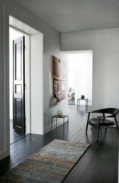 white walls, black doors