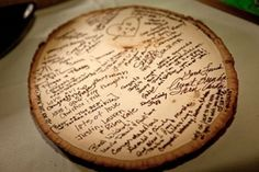 Wood Slice Guestbook – This is a very cute and cheap Idea! Of course there could be more than one slice of wood for more room and always the other side.