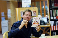 ...Are you eating cake??? Chris Corcoran in Newtown Library as part of the Get Reading, Get Better, Get Libraries campaign.