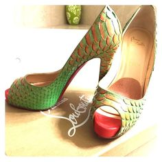Christian Louboutin Fary tale peeo toe Gorgeous snake skin green and tangerine, platform peep toe, worn once, fits like an 8 Christian Louboutin Shoes Heels