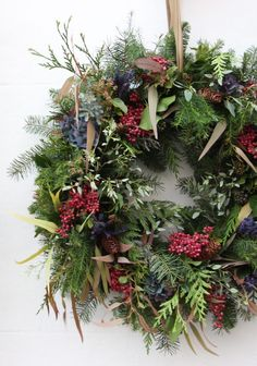 Beautiful Christmas Wreath Ideas - Brighter Beautiful Christmas Wreath IdeasBrighter CraftMake a contemporary Christmas wreath - From Britain with LoveI love this christmas wreath made with fir, pine, pink peppercorns, pine cones, blue Homemade Christmas Wreaths, Easy Christmas Decorations, Christmas Garden, Christmas Wreaths To Make, Christmas Flowers, Outdoor Christmas, How To Make Wreaths, Christmas Diy, Homemade Wreaths