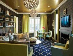 Design for a Modern Living Room with hanging lamps.   Get Ideas to 'Decorate Your House on a Budget' at http://www.constructionmarkets.com/decor/10_ways_to_decorate_your_house_on_a_budget