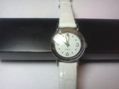 Ladies Genuine Leather Alligator Pattern Diamond Face Japan Movement Watch - Avon  White genuine leather alligator pattern band.  Silvertone hardware.  Genuine diamond on watch face.  Quartz Japan movement.  Stainless steel back.  Brand new, gift boxed....