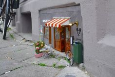 These Tiny Storefronts for Mice Are Cheesy in the Best Way — shame about all the cigarette butts.......but it is France.....shame....