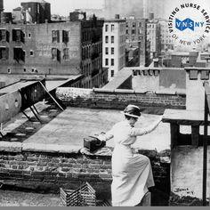 VNSNY nurse crossing the tenement rooftops circa 1900s.