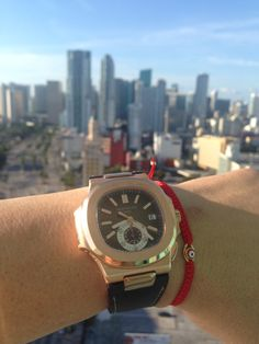 Patek Philippe Over Miami  Here's a nice shot of a Patek 5980R-001 against a backdrop of Downtown Miami. See more at:  http://www.instagram.com/crmjewelers/  #patekphilippe #luxurywatch #downtownmiami #crmjewelers