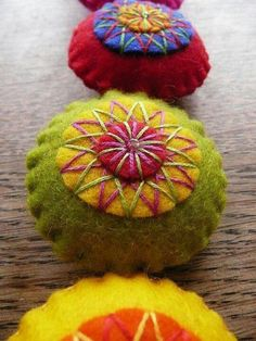 Beautiful stitches and colours...these felt cushions with hand stitches are lovely!