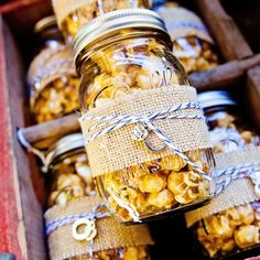Caramel Popcorn Mason Jar Favors // Katie Rivers Photography // Heavenly Gourmet Popcorn // http://www.theknot.com/weddings/album/a-rustic-whimsy-wedding-in-cleveland-ga-133465
