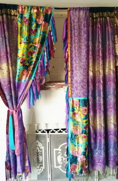 Boho Gypsy Curtains Handmade by HippieWild BOHEME STYLE ONE OF A KIND  Created with vintage textiles, and scarves, velvet. pashmina Curtains are lined in fringe made of every beautiful bit available Sari Ribbon tiebacks included  Measurements: Listing Includes (2) Panels ..Each Panel is approx 50 wide x 79 long ( 1  Rod Pocket ) Edges are raw zig zag stitched  BE HERE NOW...OHMMMMM