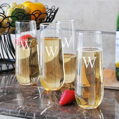 Contemporary and chic, these stemless champagne glasses give a modern edge to a barware favorite. From the curve of the glass to the slim design, this elegant set of four features a smooth silhouette