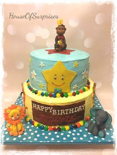 Curious George with jungle animal theme cake for 2 year old.  Cake covered in  whipcream two tier